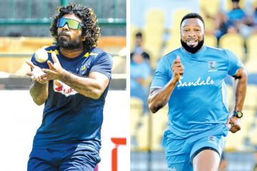 Sri Lanka T20I captain Lasith Malinga (on left) takes a catch during practice. and (on right)West Indies captain Kieron Pollard will be making his 500th T20 appearance today. AFP