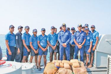 Navy personnel with the seized parcels of Kerala cannabis.