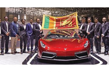 Director and co-founder of Vega Innovations Dr. Beshan Kulapala and team after unveiling the Vega EVX at the Geneva International Motor Show 2020.