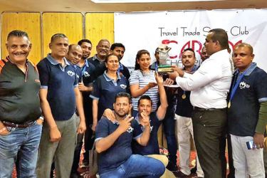Men's Team championship winner, Mt. Lavinia Hotel receiving the trophy from President /TTSC, Bonita Odayar.
