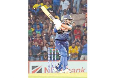 Kusal Perera during his blazing knock of 66 off 38 balls in the first T20I at Pallekele International Stadium. Picture by Kamal Jayamanna