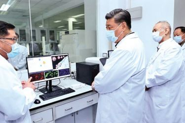 Chinese President,General Secretary of the Communist Party of China Central Committee and Chairman of the Central Military Commission Xi Jinping learns about the progress on the COVID-19 vaccine and anti-body during his visit to the Academy of Military Medical Sciences in Beijing on March 2, 2020. - XINHUA