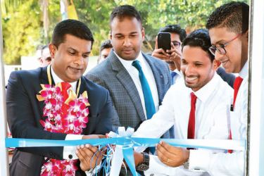 Orient Finance officials open the new branch