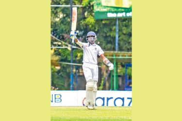 Josephian Dineth Jayakody acknowledging the cheers of the crowd after reaching his century
