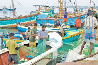 Fishermen get ready to venture to the sea.