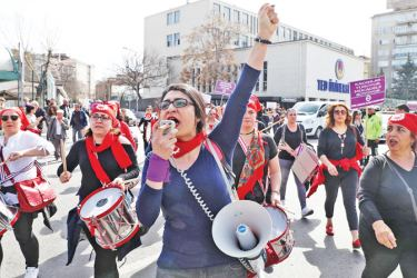 Turkish women gather to celebrate International Women's Day in Ankara on Sunday. - AFP