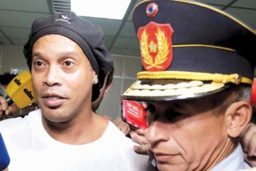Football legend Ronaldinho was arrested in Paraguay over a fake passport case