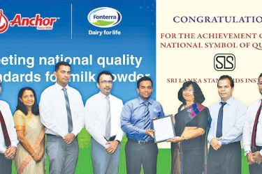 Kamal Geeganage, Director Integrated Supply Chain for Fonterra Brands Sri Lanka  accepts the permit extension from Dr. Siddhika G. Senaratne, Director General for SLSI, in the presence of dignitaries from SLSI and Fonterra Brands Sri Lanka