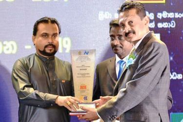Aruna de Silva, Chairman, Evergreen Group and Dr. Indika Nallaperuma, Director Evergreen Group receive the awards from Minister Wimal Weerawansa