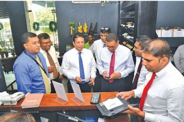 """DFCC Bank CEO Lakshman Silva performs first DFCC Pay Transaction at Sugar Bistro"""".  Denver Lewis Head of Card Centre DFCC Bank (first from left), Gemunu Gunasumana Assistant Vice President Card Operations DFCC Bank(second from left), Nishan Weerasooriya Head of IT DFCC Bank (fourth from the left), Thimal Perera DCEO DFCC Bank (Third from right) , Viraj Mudalige Group Director / Chief Executive at Epic Lanka (second from right), Chrishan Jayamanne Manager Merchant Acquiring Cards and Virtual Wallets DFCC Ban"""