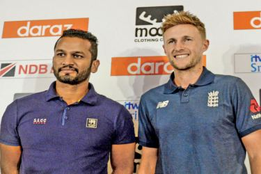 NO SHAKE OF HANDS. Rival captains Dimuth Karunaratne and Joe Root pose for a photograph at the press conference at Shangri-La Hotel yesterday. Pic by Herbert Perera