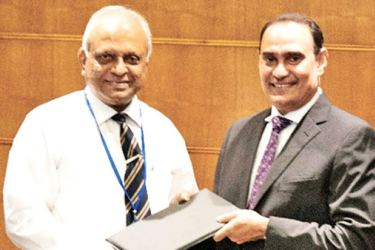 Kaushal Rajapakse, President of PRI (left) and Prof Lalith Gamage, Vice Chancellor of SLIIT (right) greeting each other after signing the MOU.