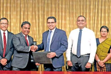 Commercial Bank's Chief Operating Officer Sanath Manatunge  and Toyota Lanka (Pvt) Ltd. Director and Chief Operating Officer Manohara Atukorala exchange the agreement in the presence of Toyota Lanka Head/Manager Shared Sales Support Anil Algama, General Manager New Vehicle Sales Department Udaya Francis, Commercial Bank Deputy General Manager Marketing Hasrath Munasinghe, Deputy General Manager Personal Banking Sandra Walgama and Deputy General Manager Corporate Banking Naveen Sooriyarachchi