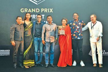 The Petal Paint team wins the Grand Prix in Print for JAT Holdings