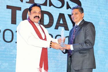 Sabry Ibrahim, CEO and General Manager of People's Leasing, receives the  Business Today Top 30 award from Prime Minister, Mahinda Rajapaksa