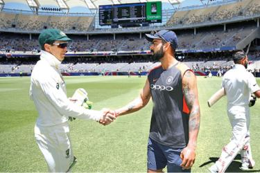 Australian Test captain Brad Haddin shakes hands with Indian captain Virat Kohli.