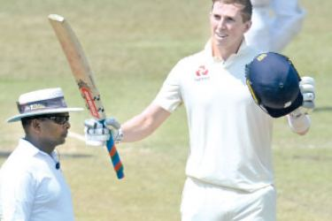 England opener Zak Crawley celebrates his century on the opening day of the 4-day warm-up match against SLC President's XI at the P Sara Oval yesterday. – AFP