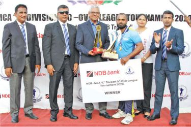 The Winning Captain from HNB Finance, Heshitha Gamage (3rd from right) receiving the NDB Challenge Trophy from the chief guest, Senior Vice President, Personal Banking Branch Network Management, NDB Bank, Sanjaya Perera (3rd from left). Others in the picture (from left): Sirosha Gunatillake, General Secretary and Rohana Dissanayake, President (both from MCA) Lanka Aviriwatte, Senior Manager Marketing, NDB Bank and Tarindra Kaluperuma, Chairman Tournament Committee, MCA.