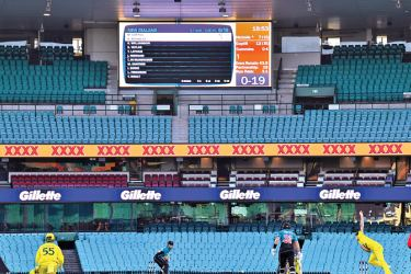 New Zealand batsman Henry Nicholls (C) plays a shot in front of an empty grandstand during the first one-day international (ODI) cricket match against Australia in Sydney on Friday. - AFP