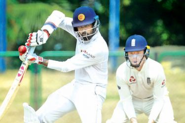 Sri Lanka Cricket President's XI skipper Lahiru Thirimanne plays a shot during the second day of the four-day practice match against England at the P. Sara Oval yesterday. – AFP