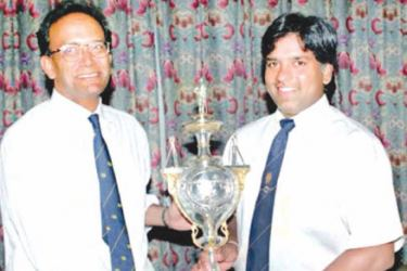FLASHBACK TO 1996: Ana Punchihewa and Arjuna Ranatunga with the most prized possession the Cricket World Cup.