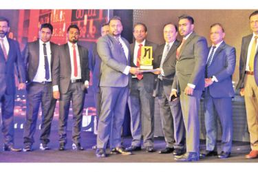 HNB Finance Udara Gunasinghe, Head of Marketing together with Lasantha Sanjeewa, Senior Manager Treasury receives the award