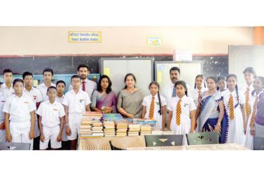 Schoolchildren with Pan Asia Bank Head Office staff at the book donation