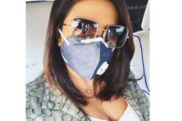 Actress Priyanka Chopra Jonas wears a protecive mask while travelling.