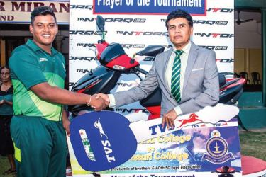Ravi Liyanage – TVS Chief Executive Officer handing over the bike to the Man of the tournament in Thurstan - Isipathana match