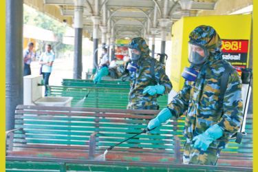 Spraying disinfectants at Colombo Fort Railaway Station as a preventive measure against the COVID-19. Pictures by Nishanka de Silva