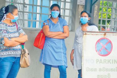 Wearing face masks to protect against coronavirus. Picture by Ranjith Asanka