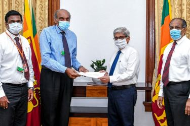 Dr. Hector Weerasinghe, Director - Medical, Regulatory & Government Affairs - GlaxoSmithKline Pharmaceuticals (second from left) and Chanaka Wanniarachchi, Supply Chain Lead - GSK Consumer Healthcare (from left) hand over the donation of Rs. 5 Million to Prof. W. D. Lakshan, Governor of the Central Bank of Sri Lanka (centre).