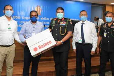 Commander of the Sri Lanka Army and Acting Chief of Defense Staff Lieutenant General Shavendra Silva and Lt. Colonal Vindana Kodithuwakku receiving the PP Equipment from Rainco (Pvt.) Ltd.'s Chief Operating Officer – Ahamed Aroos, Managing Director – Fazal Fausz and Group Head of Tenders and Regulatory Affairs – Prasanna Chandrasiri