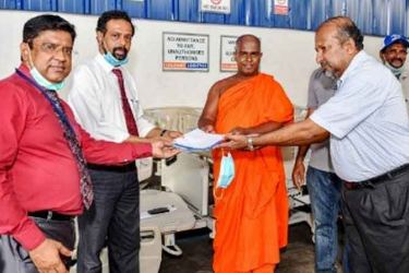 The donation being handed over by Sanath Marasinghe to the Government in Colombo on April l 30.