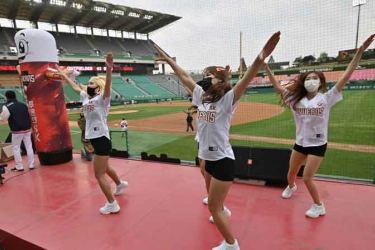 Cheerleaders dance during the opening game of South Korea's new baseball season between the SK Wyverns and Hanwha Eagles at Munhak Baseball Stadium in Incheon on Tuesday. - AFP