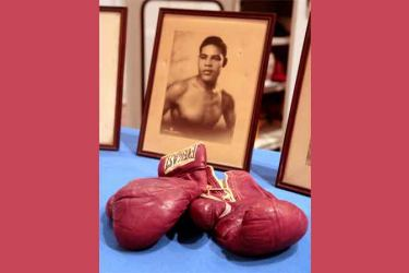 The boxing gloves that heavyweight champion Joe Louis used in his first fight against Germany's Max Schmeling in 1936 are shown at the Smithsonian's National Museum of American History in Washington, January 31, 2007.