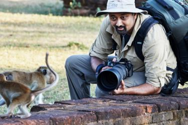 Sandesh Kadur approaches a primate in the ancient city of Polonnaruwa, Sri Lanka.