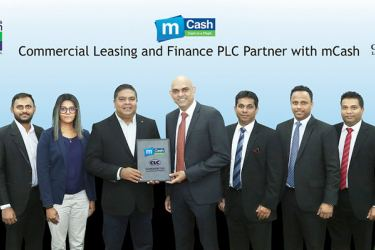 Krishan Thilakaratne Director and CEO CLC exchange the MoU with Nalin Perera CEO, Mobitel, flanked by Hiranya Karunaratne Product Executive, Mobile Financial Services, Shehan Perera Assistant Manager, Mobile Financial Services, Rishani Gunaratne Manager, Mobile Financial Services, Manusha Samarakoon Coordinator, Micro Finance, Dilan Jayawardena Senior Business System Analyst, Uditha Panawennage Manager, Microfinance Marketing, Harsha Kumarage Head of Micro Finance Business Unit.
