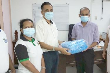 Udaya Padmakumara, Head of Research and Development at Elephant House, Nisansala Paranayapa, Head of HR at John Keells Holdings Consumer Food Sector and Sanjeewa Jayasundara, Head of Supply Chain at Elephant House hands over the donation of  Personal Protection Equipment to Dr. Hettiarachchi, Medical Superintendent, Base Hospital Homagama.
