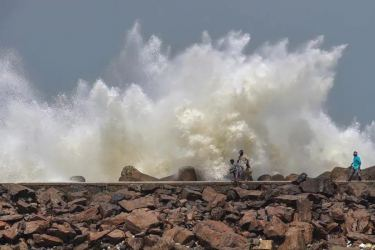 Turbulent waves crash into the coast Kasimedu Fishing Harbour, ahead of landfall by Cyclone Amphan in Chennai, India on Tuesday. - PTI Photo