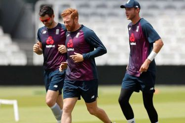 File photo. The bowlers' identities have yet to be made public but the choice of venues indicates that James Anderson (Old Trafford, left)) and Stuart Broad (Trent Bridge, right) will be among the leading England bowlers training at their home county grounds.
