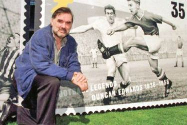 Manchester United great George Best poses with a life-size version of a Royal Mail stamp featuring former United midfielder Duncan Edwards.