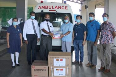 The District General Hospital Hambantota officials accepts the Personal Protective Equipment from HIP officials.