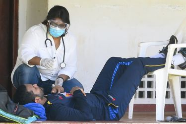 Dimuth Karunaratne being attended to by the medical staff at the CCC pavilion yesterday. (Pic by Ishara Kodikara, AFP)