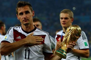 Germany's Miroslav Klose holds the World Cup trophy after the 2014 World Cup final against Argentina at the Maracana stadium in Rio de Janeiro July 13, 2014.