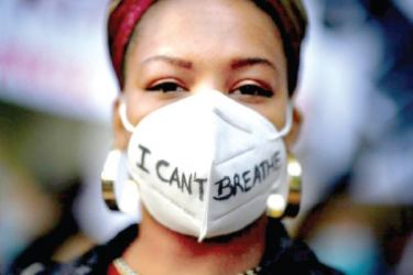 "Thousands of people gathered in a number of European cities to protest against racism. Here, a woman wearing a ""I can't breathe"" mask during a demonstration in Madrid, Spain following the death of George Floyd in Minneapolis, Minnesota, US on May 25."