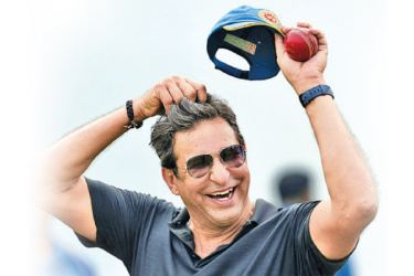 Wasim Akram says being unable to polish the ball with saliva could turn bowlers into robots, but that cricketers should live with it. - AFP