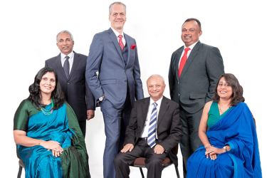 Standing (L-R) Janaka Gunasekera, Deputy MD and Director Agriculture; Rolf Blaser, MD and CEO; Nishantha Weerasinghe, Director Healthcare; Seated (L-R) Pavithra Samarasinghe, Director Finance; Lakshman Niyangoda, Non-Executive Chairman, and Anoja Basnayake, Director IT
