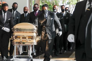 Relatives with the golden casket bearing the remains of George Floyd at his funeral