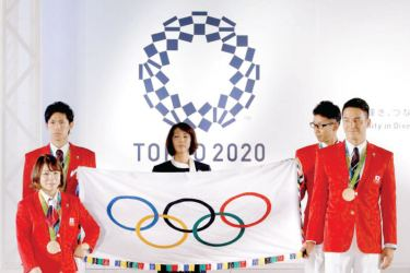 A push is on to allow athletes to protest against racism at next year's rescheduled Tokyo Olympic Games.
